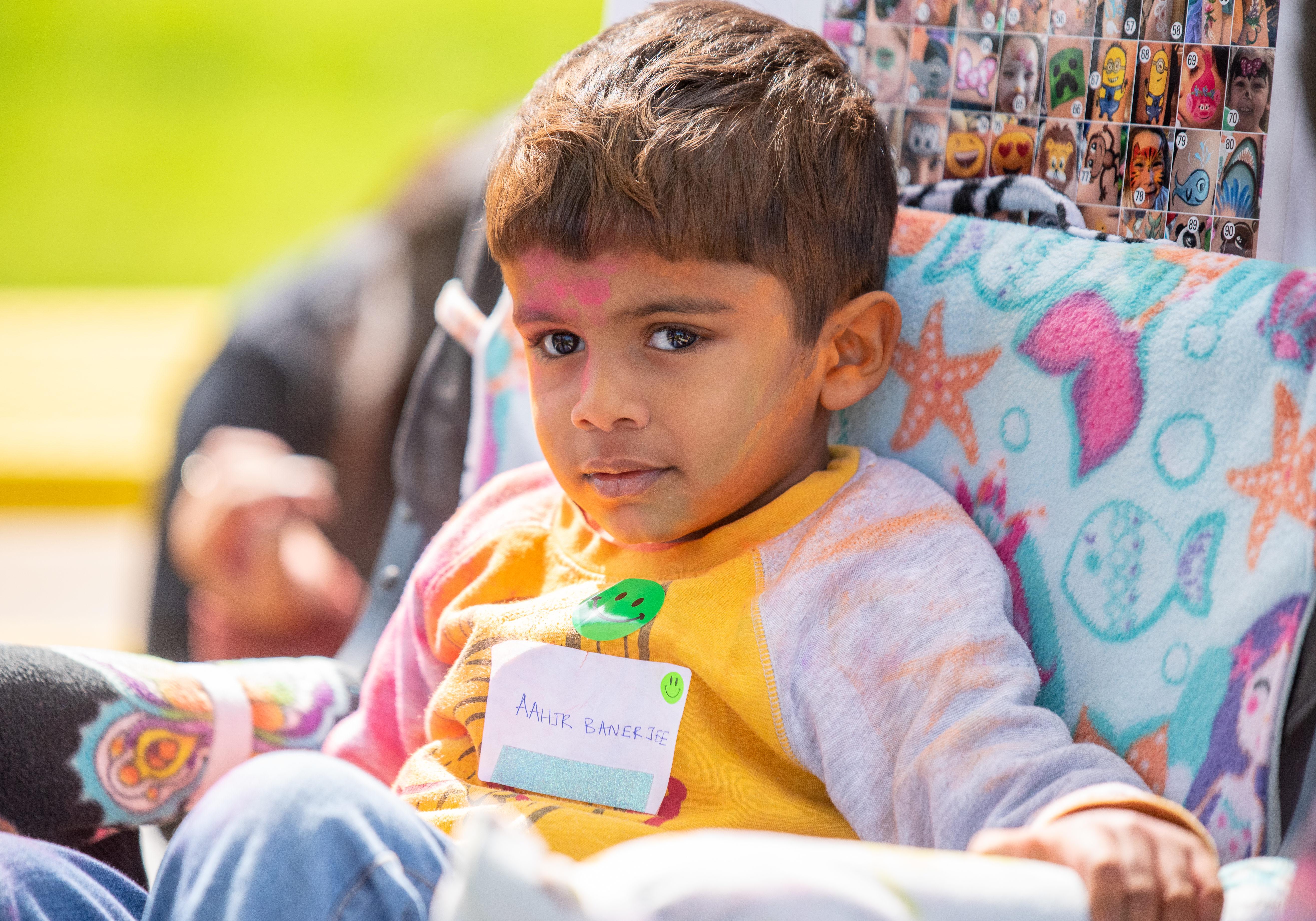 Kid sitting outside