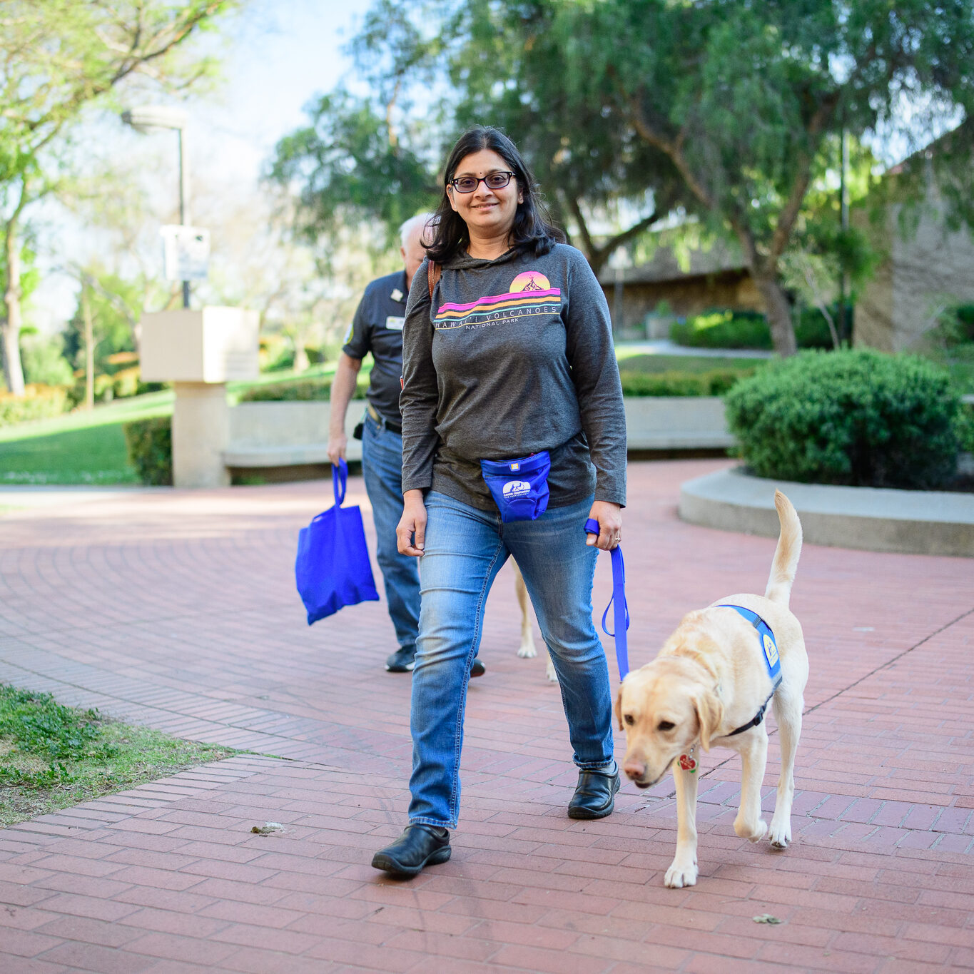 woman proudly walks service dog