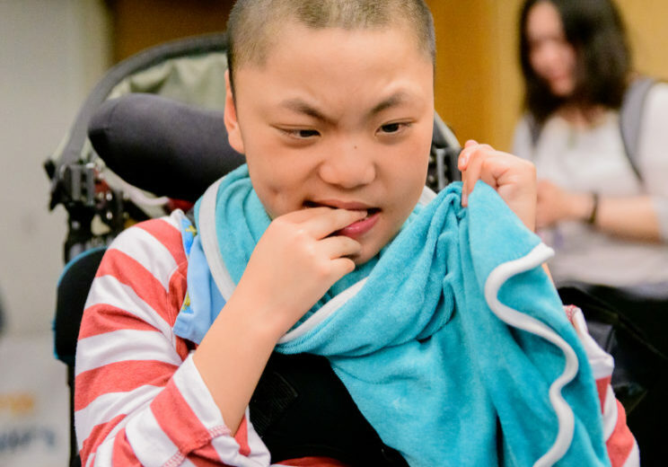 boy in wheelchair with towel