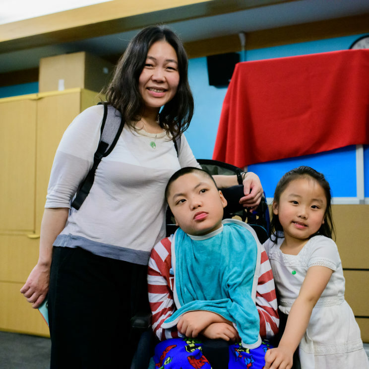 boy with disabilities in with his sister and mother